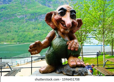 GEIRANGER, NORWAY - MAY 22, 2019: Troll monument in Geiranger, Norway. Troll is a class of being in Norse mythology and Scandinavian folklore. Trolls may look and behave exactly like human beings.