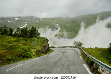 Geiranger, Norway, the road of the eagles. The road among the mountains of Geiranger ends with a very steep serpentine. This is the so — called road of eagles-very narrow and extreme.