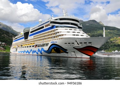 GEIRANGER, NORWAY-AUGUST 5: Cruise ship anchored in Geiranger fjord, Gieranger, Norway on August 5, 2010. The AIDA luna  is 252 m long, has passenger capacity of 2050, 15 decks, 1096 cabins