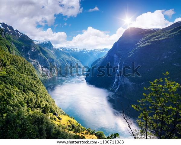 Geirangerfjord fjord. View of the old mountain farm and the Seven Sisters waterfall, Norway. Popular tourist attraction near the city of Geiranger