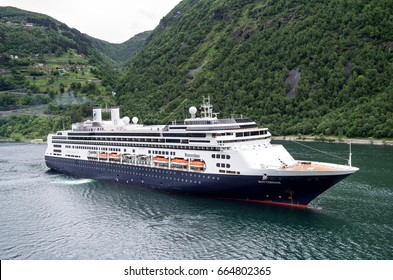 GEIRANGERFJORD, NORWAY - June 7, 2017: ROTTERDAM of Holland America Line. Holland America Line was founded in 1893 and is a subsidiary of Carnival Corporation & plc since 1989.