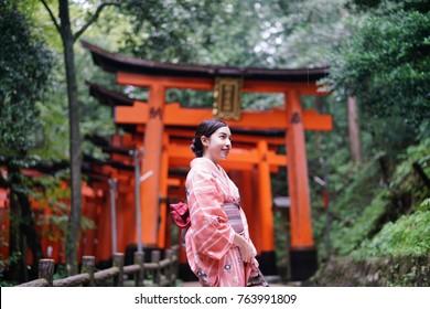 Geisha wearing traditional Japanese Kimono , fushimi inari
