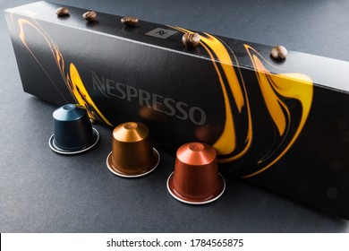 Gela, Italy – 11/03/2019: nespresso brand, Abstract and conceptual of home coffee espresso machine. isolated on black background. Coffee machine with cup  coffee and foam. Graphic resources with copy