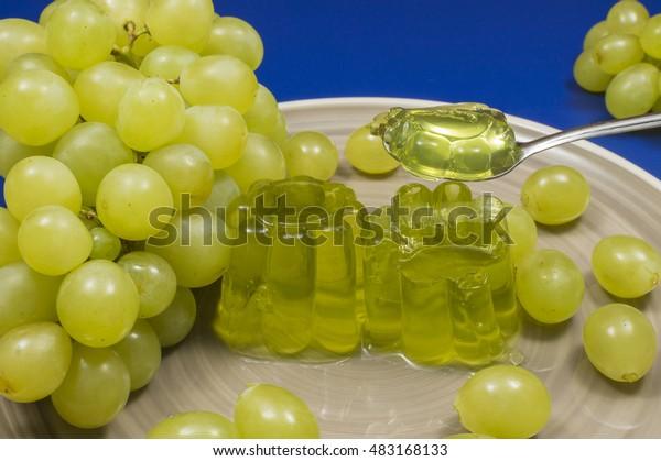 gelatin on spoon, white grape jelly, fruit dessert homemade, bunch of grapes