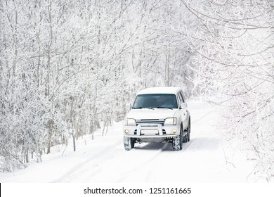 Gelendzhik, Russia, 26 February 2018: White jeep Toyota Land Cruiser Prado 90 on snowy off road in beautiful fairy winter forest among trees.