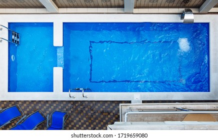 Gelendzhik, Russia, 30.08.2016: Top view swimming pool with clear blue water at hotel, close up. Swimming, relaxation, tanning and relaxation.