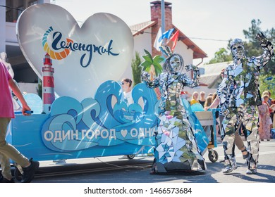 Gelendzhik, Russia - June 1, 2019: A couple walks on the street in costumes during the Summer Carnival for Celebration of the opening of the holiday season.