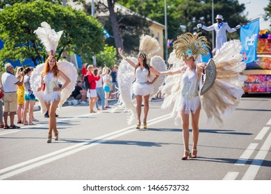 Gelendzhik, Russia - June 1, 2019: Three women walk on the street in costumes during the Summer Carnival for Celebration of the opening of the holiday season.
