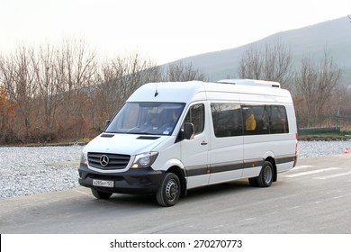 GELENDZHIK, RUSSIA - NOVEMBER 16, 2014: White passenger van Mercedes-Benz Sprinter at the interurban road.