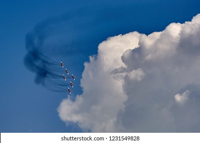 Gelendzhik, Russia - September 5, 2018: An aviation group of six MiG-29 aircraft demonstrate a pyramid shape against a clean blue sky. Strizhy aviation group.