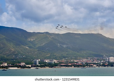 Gelendzhik, Russia - September 5, 2018: An aviation group of six MiG-29 aircraft demonstrate a pyramid figure against the backdrop of the Gelendzhik resort. Strizhy aviation group.
