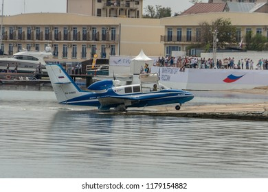 Gelendzhik, Russia - September 6, 2018: Be-103 amphibian plane returns to base after demonstration flights over the Black Sea water area on Hydroaviasalon (Gidroaviasalon) 2018