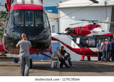 Gelendzhik, Russia - September 7,2018: Visitors to the exhibition examine and photograph the helicopters on the demonstration site of the hydroaviation exhibition Hydroaviasalon 2018.