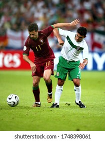 Gelsenkirchen, GERMANY - June 21, 2006:  Simão and Sinha in action  during the 2006 FIFA World Cup Germany  Portugal v Mexico at the Gelsenkirchen Stadium.