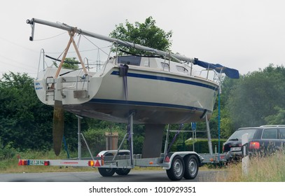 GELSENKIRCHEN, GERMANY - JUNE 25, 2005: Transportation of a sailboat with folded mast on a boat trailer in Gelsenkirchen, Germany.