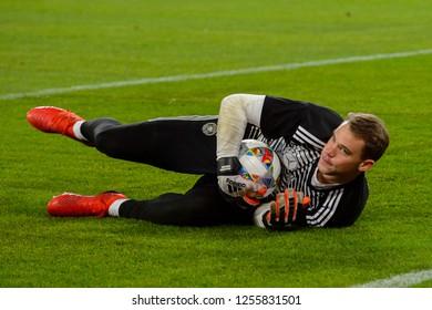 GELSENKIRCHEN - NOV 19, 2018: Manuel Neuer 1 warms up gets the ball. Germany - Netherlands. UEFA Nations League. Schalke 04 stadium.