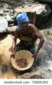 A gem panner in the process of panning for gems and crystals. Sri Lanka