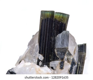 Gem quality Green Tourmaline crystal on matrix with a nice clear topaz from Pakistan isolated on white background.