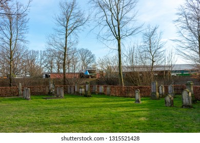 "Gemen, NRW / Germany - 16 February, 2019: Jewish cemetery from 1810. The youngest graves are from 1912/1913. On most tombstones is written in Hebrew ""Here is a Jewish man"""