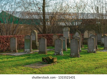 "Gemen, NRW / Germany - 16 February, 2019:Jewish cemetery from 1810. The youngest graves are from 1912/1913. On most tombstones is written in Hebrew ""Here is a Jewish man"""