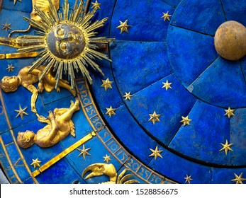 Gemini astrological sign on ancient clock. Detail of Zodiac wheel with Sun and Twins. Golden symbol of Gemini on star circle closeup. Concept of astrology and horoscope.