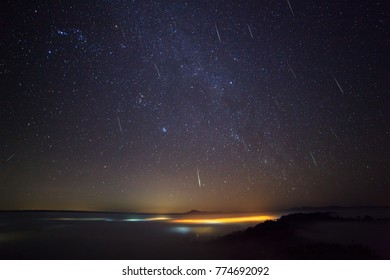 Geminid Meteor in the night sky and fog at Khao Takhian Ngo View Point at Khao-kho Phetchabun,Thailand
