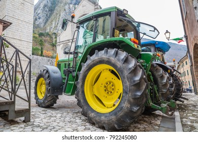 GEMONA, ITALY - NOVEMBER, 2017: close up of modern green tractor in autumn market in Gemona Friuli-Venezia Giulia, Italy