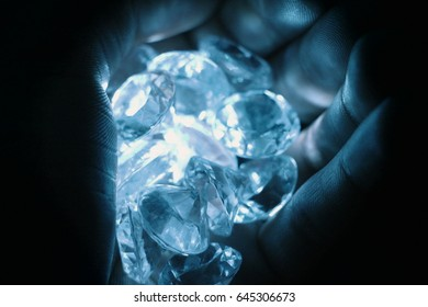 gems in hand in cool tone
