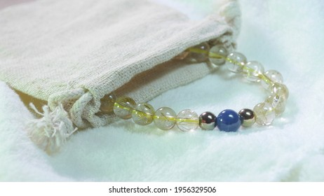 ฺBracelet gemstone beads of Golden Rutile Quartz , Kyanite and Pyrite.