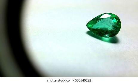 gemstone emerald isolated on white background a