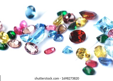 Gemstone facet cutting fancy multiple color sapphire variety shape on white paper background with selective focus