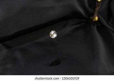 Gemstone isolated on black background. Diamond  jewelry on a black background. Elegant jewelry with jewel stone. precious or semiprecious stone, especially one cut in a piece of precious jewelry