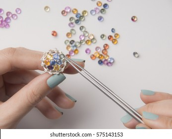 gemstone selection in jewelry making on white gold casting ring.