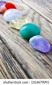 Gemstones against wooden background