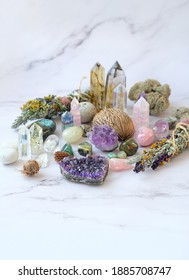 gemstones crystals, floral cleansing bundles, magic things on marble background. healing Crystals Stones for Witchcraft, Esoteric spiritual practice. wiccan modern magic, relaxation, meditation