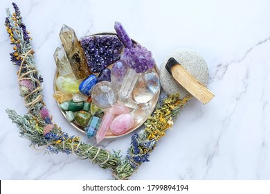 gemstones crystals, palo santo, floral cleansing bundles on table. minerals for healing crystal Ritual, esoteric spiritual practice, relaxation, meditation, reiki therapy, open chakras, Witchcraft