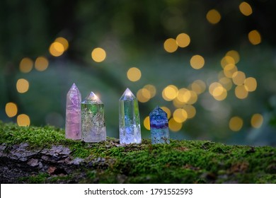 gemstones minerals on mysterious natural background. fluorite, clear and rose quartz crystals. Magic Rock for Crystal Ritual, Witchcraft, healing spiritual practice