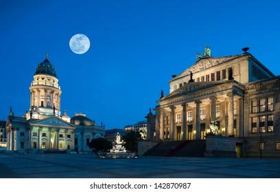 Gendarmenmarkt square in Berlin under a harvest Moon