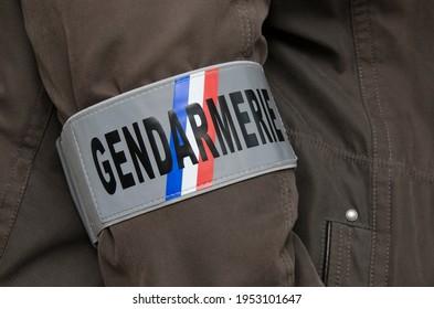 Gendarmerie armband worn on a jacket by investigator