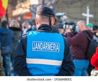 Gendarmerie officers(Translation text: Military police) closely supervising the demonstrators from University square, Bucharest at the protest against anti covid vaccine.