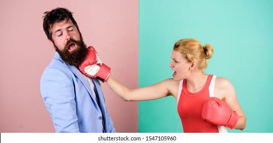 Gender equal rights. Couple in love competing in boxing. Conflict concept. Gender battle. Family quarrel. Strong punch. Boxers fighting in gloves. Gender equality. Man and woman boxing fight.