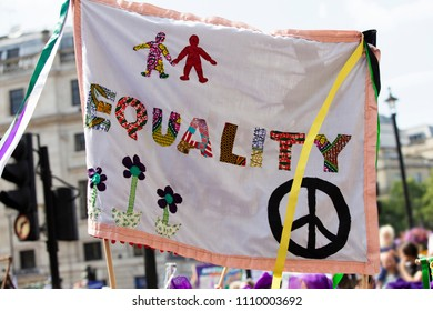 A gender equality banner at a feminist protest march
