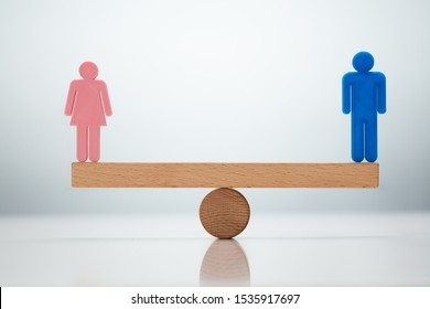 Gender Equality Concept. Male And Female Balancing On Seesaw
