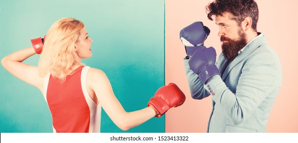 Gender equality. Man formal suit and athletic woman boxing fight. Couple in love competing in boxing. Female and male boxers fighting in gloves. Domination concept. Gender battle. Gender equal rights.