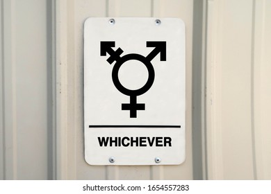 Gender neutral restroom sign that says, WHICHEVER.
