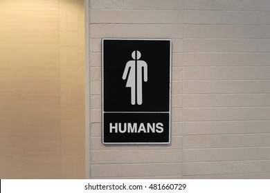 "Gender Neutral Restroom sign that says, ""Humans"""