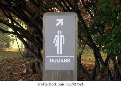 Gender neutral sign, outdoors, that says, HUMANS