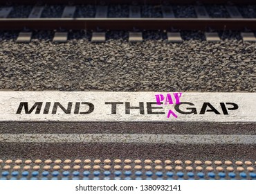 Gender pay gap, Mind the pay gap graffiti in pink, pay inequality concept – Image
