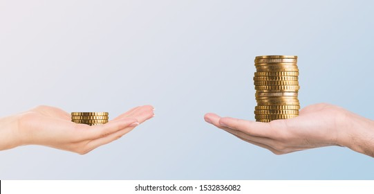 Gender pay gap, sexism at bookkeeping. Male hand holding more money then female, panorama, free space