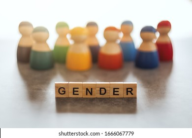 GENDER word on wooden blocks with diverse people in the background